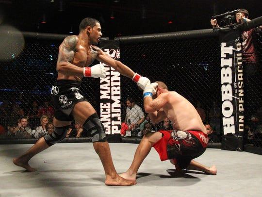 Tallahassee's Rafael Valdez punches at Jimmy Alexander