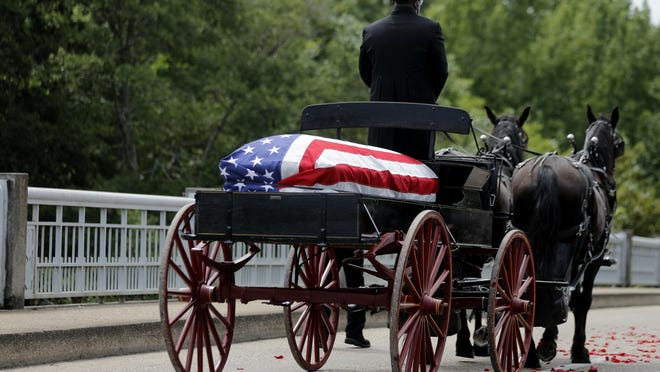 The casket of Rep. John Lewis moves over the Edmund Pettus Bridge by horse-drawn carriage during a memorial service for Lewis on July 26 in Selma, Ala. Lewis, who carried the struggle against racial discrimination from Southern battlegrounds of the 1960s to the halls of Congress, died July 17.