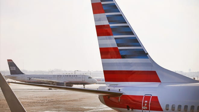 Woman was arrested in New York City after boarding American Airlines jet having allegedly stolen Apple products.
