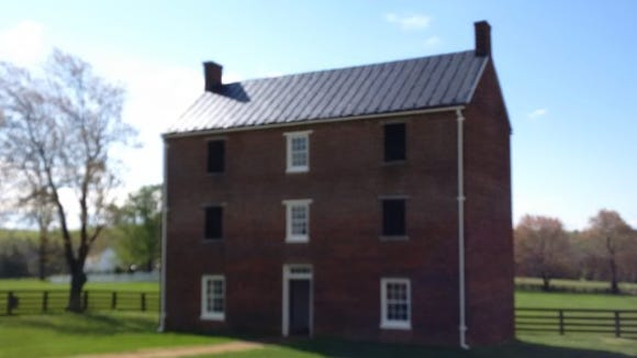 The restored three-story high brick county jail. Window have several layers of iron bars, so cutting through one layer left the would-be escapee with a lot ore work yet to go.