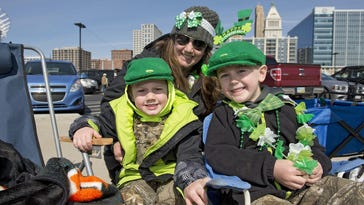 Logan, Kim and Sam Rumpke wait for the St. Patrick's Day Parade.