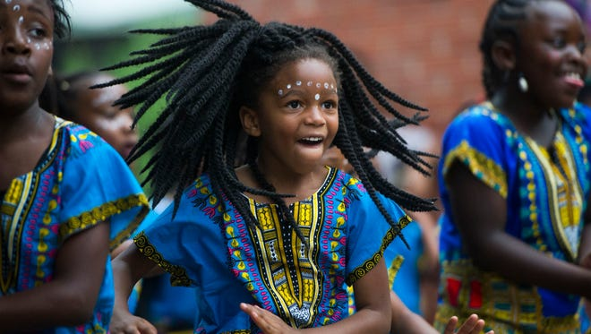 Kahlaya Jordan, 5, dances with the Kuumba Watoto Dance and Drum Company in Market Square Friday, June 23, 2017. The Kuumba Festival is one of the largest African American cultural arts festivals in East Tennessee.