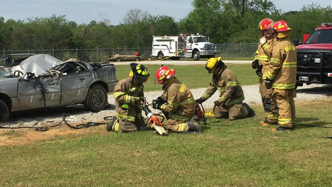 Firefighters get ready to perform a full extrication on a junked car Saturday during the Ruby-Kolin Fire Department's Community Safety Day.