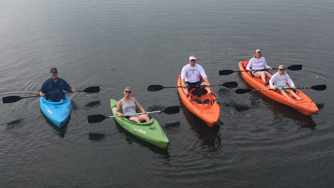 Jennifer Trefelner (in the green kayak) and her family recently went kayaking with friends at Round Island Park in Vero Beach.