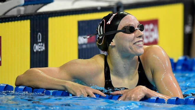 Hali Flickinger reacts as she checks her time after the women's 200-meter butterfly final at the U.S. Olympic swimming trials, Thursday in Omaha, Neb. Flickinger placed second and will be headed to the Rio Olympics in August.