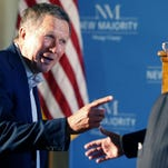 John Kasich is seeking to stick with other experienced contenders in the race for the GOP nomination for president. Here Kasich, left, meets donor George Argyros, ex-ambassador to Spain, at a luncheon of well-heeled Republicans in Irvine, California.