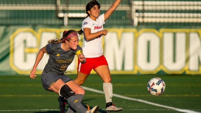 The University of Vermont's Brooke jenkins boots the ball against Marist College in Burlington on Tuesday, September 12, 2017.