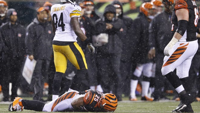 Cincinnati Bengals running back Giovani Bernard lies motionless after a hit by Pittsburgh Steelers linebacker Ryan Shazier on Saturday.
