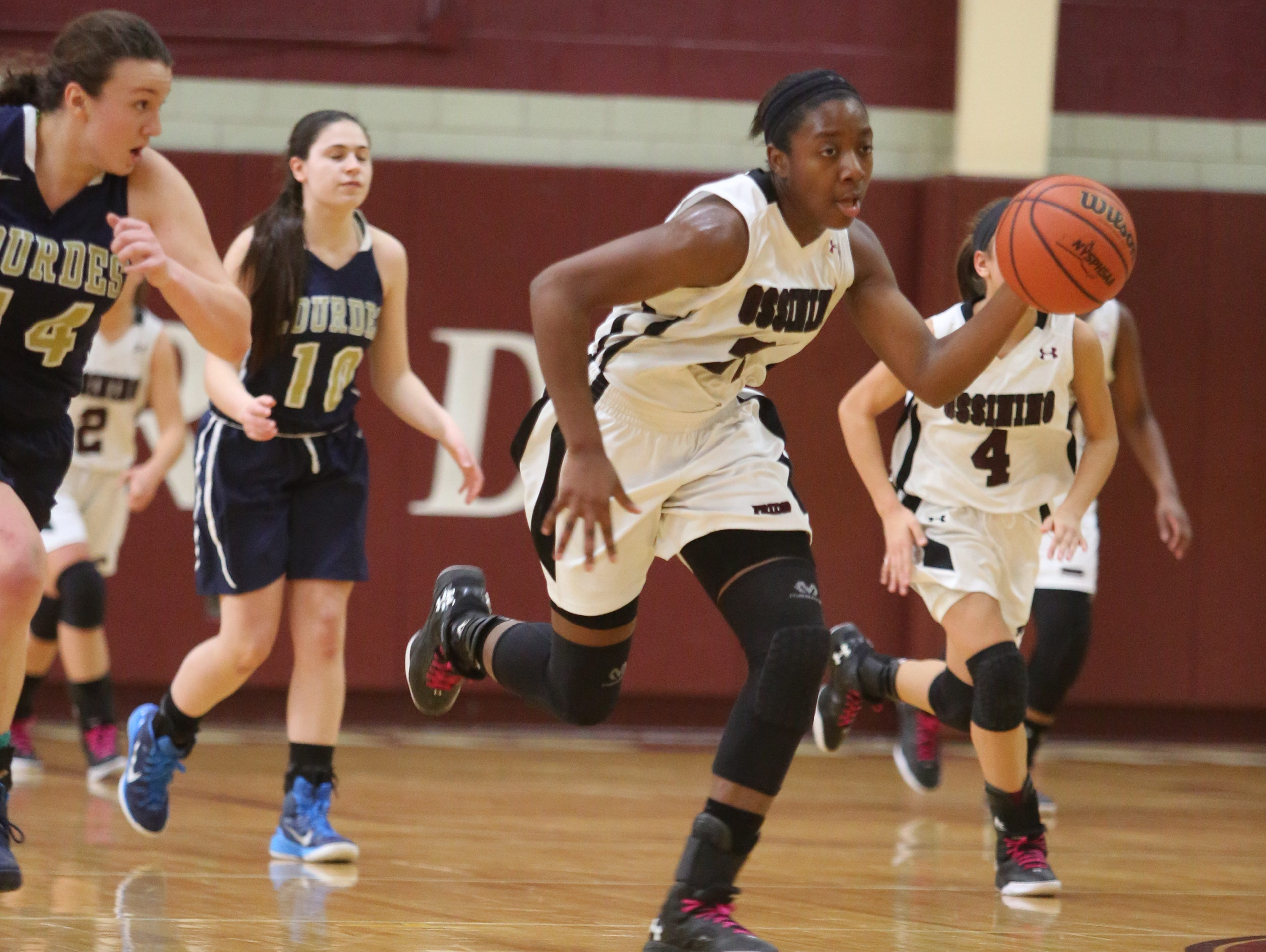 Ossining's Shadeen Samuels moves the ball downcourt as they play Our Lady of Lourdes in Ossining, Feb. 20, 2016. Ossining beat Lourdes, 90-27.