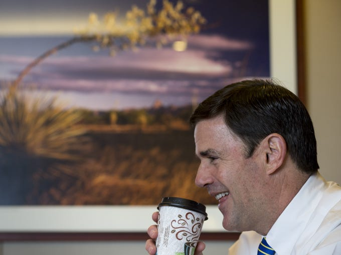 Gov. Doug Ducey answers questions during an interview,