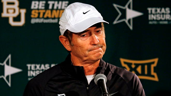 Baylor football coach Art Briles shrugs his shoulders as he discusses Baylor being left out of the College Football Playoff Dec. 7, 2014, in Waco, Texas.