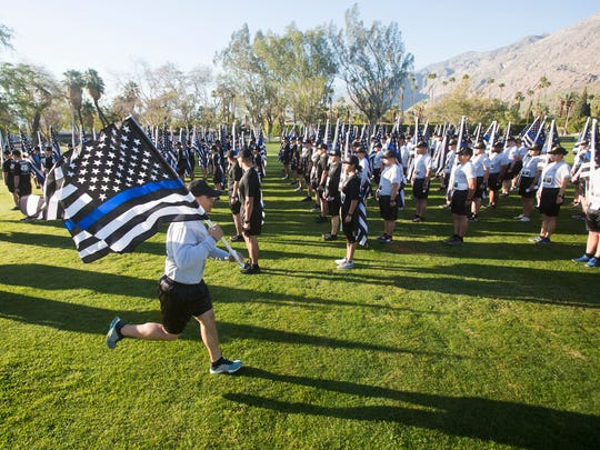 """San Bernardino Police Academy cadets participate in a five kilometer benefit run for the families of Officer Jose """"Gil"""" Vega, Officer Lesley Zerebny who were shot dead in October of 2017 in Palm Springs, California. The run took place at Ruth Hardy Park in Palm Springs."""