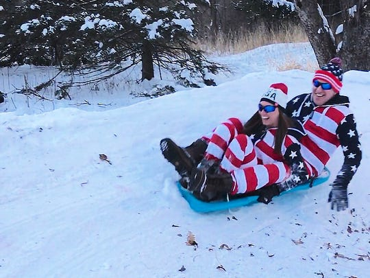 The Leibham Luge team rides their sled at the Leibaham Olympics 2018, in Sheboygan, Wis.