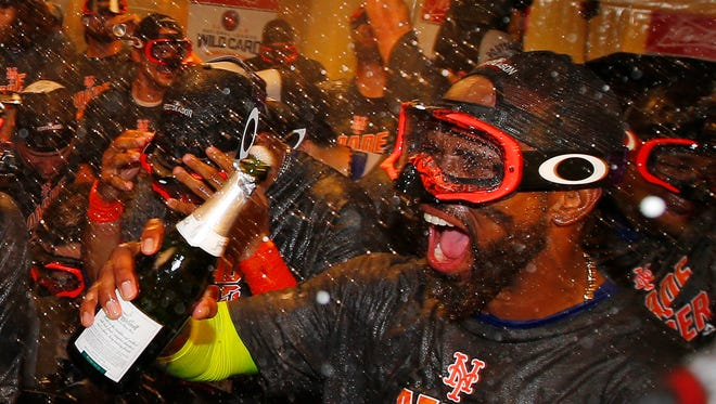 Jose Reyes #7 of the New York Mets celebrates with his teammates after the Mets defeated the Philadelphia Phillies 5-3 during a game at Citizens Bank Park on October 1, 2016 in Philadelphia, Pennsylvania. The win clinched a Wild Card game for the Mets.