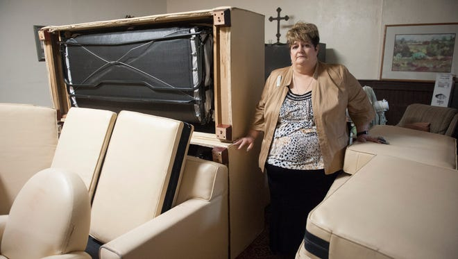Vicky McCristal, Dir. of Sales and Marketing for Wyndham Hotel in Mt. Laurel, donated couches and chairs to St. Paul's Episcopal Church in Camden. Thursday, February 25, 2016.