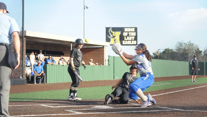 Kaylie Hewitt covers home plate while Hobbs' Samantha Perez scores from third on a wild pitch on Friday.