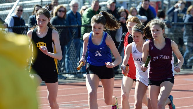 Runners at the start of division A,B,E distance medley at the 57th annual Jack Yockers Bergen County Relays at River Dell High School.