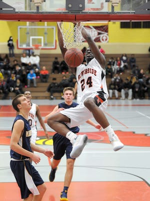 Milwaukee Riverside''s Terrence Lewis breaks away from Marquette defenders and dunks the ball during the Terry Porter Classic Saturday, Dec. 3 at Milwaukee South High School. For The Journal/Sentinel Michael McLoone