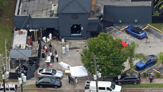Aerial view Sunday, June 12, 2016 of the mass shooting scene at the Pulse nightclub in Orlando, Fla. A gunman opened fire inside a crowded gay nightclub early Sunday, before dying in a gunfight with SWAT officers, police said. (Red Huber/Orlando Sentinel via AP)