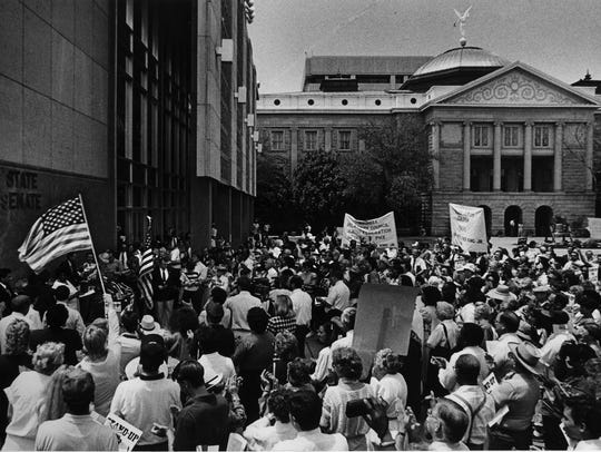Crowds rally for a Martin Luther King Jr. holiday at the Arizona State Capitol in 1988.