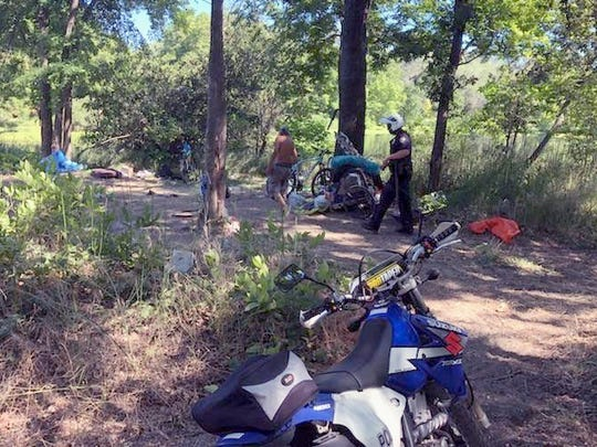Redding police used all-terrain motorcycles to conduct a sweep along the Sacramento River Trail and park areas in the summer of 2018.