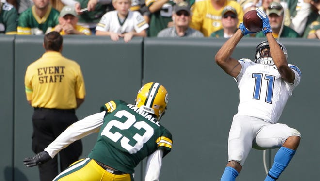 Lions receiver Marvin Jones hauls in a touchdown catch in front of Green Bay's Micah Hyde in the fourth quarter Sunday, Sept. 25 at Lambeau Field. The former Cincinnati Bengal caught six passes for a career-high 205 yards and two touchdowns.