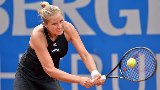Shelby Rogers of the United States returns a ball during her final match against Germany's Andrea Petkovic at the WTA tennis tournament in Bad Gastein, Austria, Sunday, July 13, 2014. Petkovic won with 6-3 and 6-3. (AP Photo/ Kerstin Joensson)