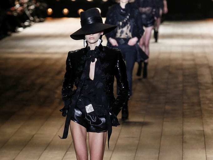 A model wears a creation for Saint Laurent's ready-to-wear