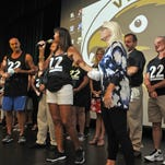 At right is a display from Fight-22, an organization that works to prevent veteran suicide. The soldier featured is Matthew Preacher, an Army Ranger from Titusville whose traumatic combat experiences led him to taking his own life. The medals  A 22 Push Up Challenge was held at Viera High School Friday evening to bring awareness to the estimated 22 veteran suicides that take place every day in America. Guest speakers spoke of PTSD, several elected officials, veterans, and supporters and joined in the push up challenge.