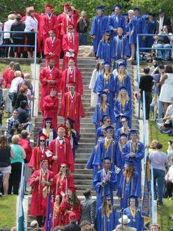 Graduates from the Sheboygan Area School District file down the steps to the bowl to start the graduation ceremony Sunday, June 7, at Vollrath Bowl in Sheboygan.