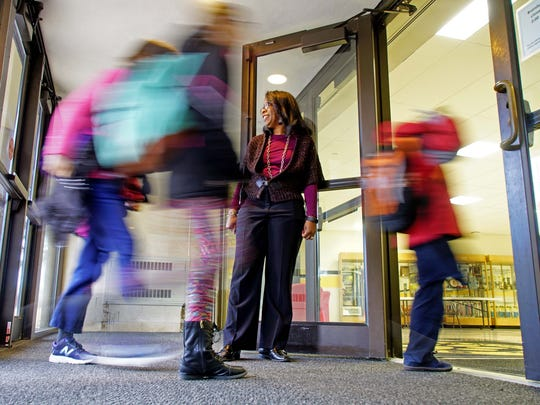 Stephanie Armstrong, principal at Brandywine Springs School, greets her students at the front door every morning as they arrive for school.