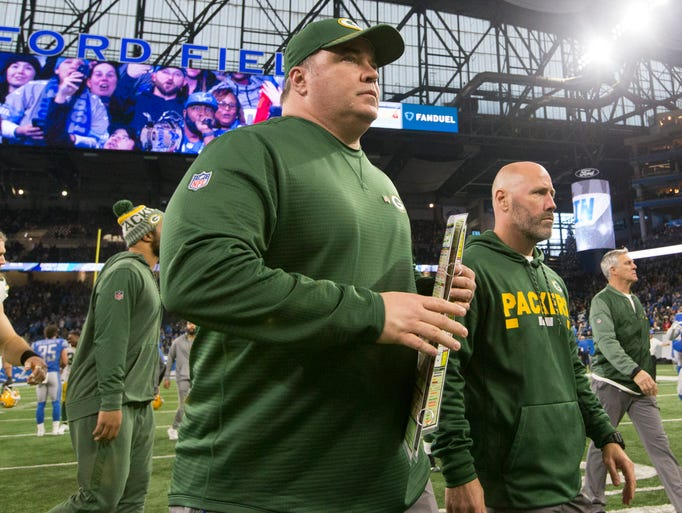 Green Bay Packers head coach Mike McCarthy leaves the