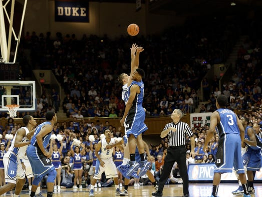 Duke's Jabari Parker and Marshall Plumlee (40) jump for the tipoff to start the Blue-White scrimmage during the team's Countdown to Craziness preseason event.