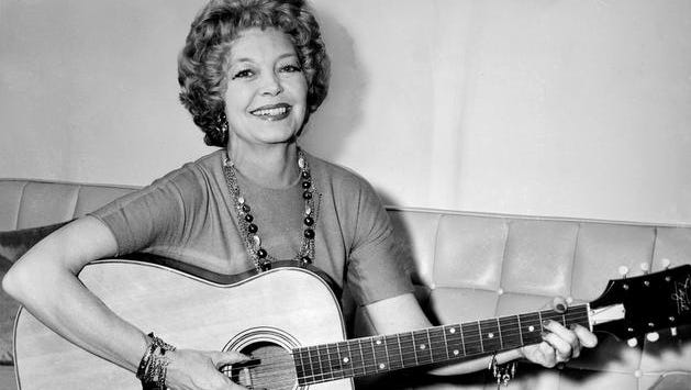 Texas songwriter Cindy Walker tries a new tune during one of her frequent visits to Nashville on June 21, 1963.