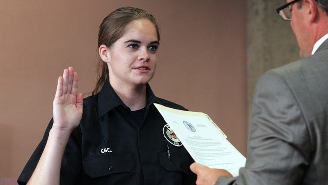Ashley Ebel is sworn in by Safety Director Bill Spurgeon.