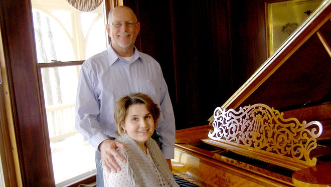 Ken and Barb Kipe and their historic Steinway.