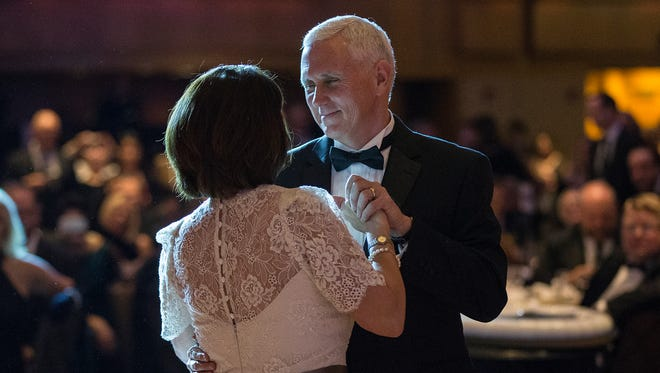 "Vice president-elect Mike Pence and Karen Pence share a dance to ""My Girl"" at the Indiana Society Ball, the evening before the presidential inauguration, at the Grand Hyatt, Washington D.C., Friday, Jan. 19, 2017."