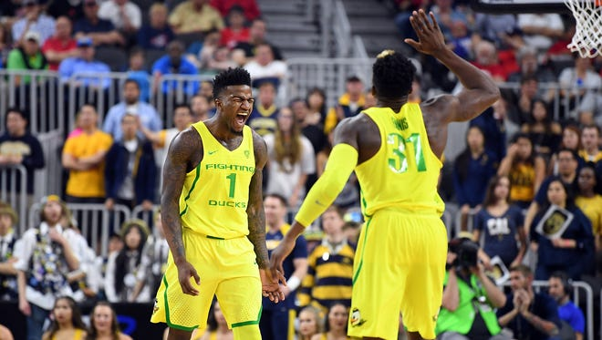 Mar 10, 2017; Las Vegas, NV, USA; Oregon Ducks forward Jordan Bell (1) celebrates with guard Dylan Ennis (31) during a Pac-12 Conference Tournament game against the California Golden Bears at T-Mobile Arena. Mandatory Credit: Stephen R. Sylvanie-USA TODAY Sports