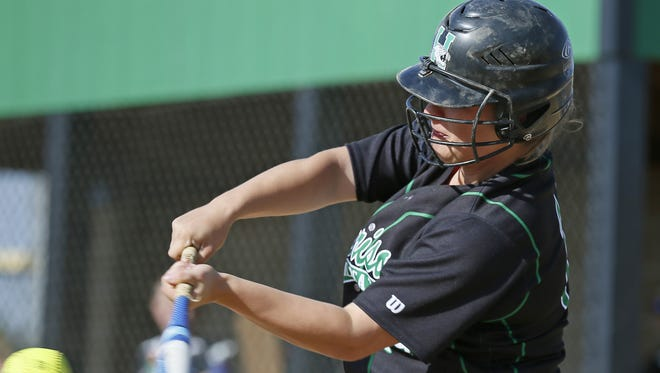 Harrison senior Shelby Scott sends a shot deep for a triple during the bottom of the fourth inning.