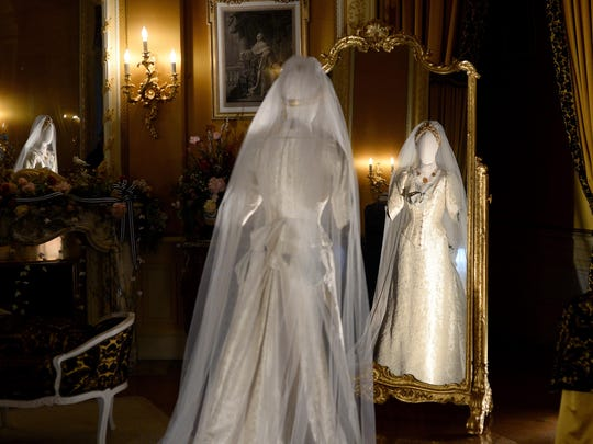 "A dress worn by actress Julie Christie in Hamlet is on display in Mrs. Vanderbilt's bedroom of the Biltmore House on Friday, Feb. 12, 2016. ""Fashionable Romance: Wedding Gowns in Film"" is on display at the estate through July 4."