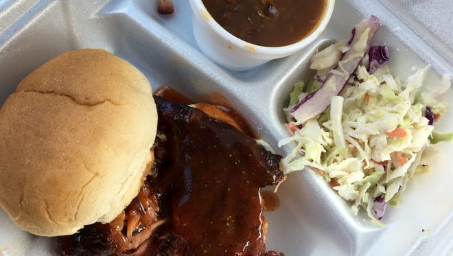 A rib sandwich with slaw and beans from Smokin R's BBQ in Bonita Springs. The barbecue food truck recently moved into a brick-and-mortar location off Old 41 Road.