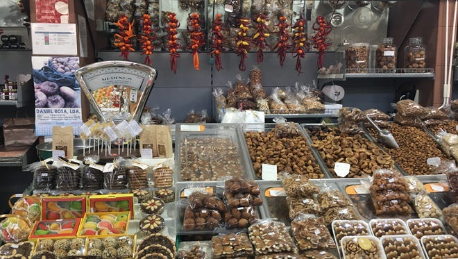 Peppers hang over a stand of confections made with dried figs, crushed almonds and honey — the original energy bars.
