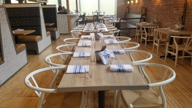 Large tables easily combine to become communal tables at The Garden Table, 342 Massachusetts Ave.