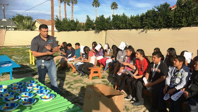 Students get a few pointers on vegetable gardening.