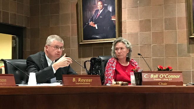 Greenville County Schools Superintendent Burke Royster addresses the school board. At right is board chairwoman Crystal Ball O'Connor.