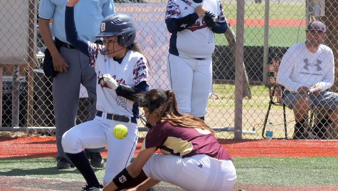 Senior short stop Aileen Granillo came home to score on a wild pitch during a two-run third inning against Gadsden High Saturday at Hooten Park. Looking on at right is on-deck batter senior Erika Lopez.