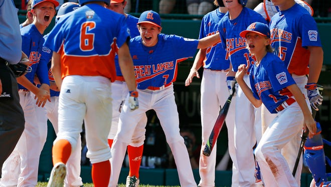 Grosse Pointe, Mich.'s Joey Radanzzo (6) is greeted by teammates after hitting a solo-home run during the second inning of an elimination baseball game against Jackson, N.J, United States pool play at the Little League World Series tournament in South Williamsport, Pa., Saturday, Aug. 19, 2017. New Jersey won 15-5.