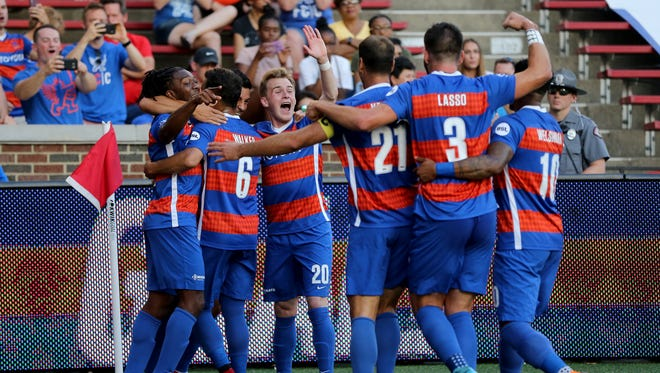 FC Cincinnati celebrates FC Cincinnati midfielder Dekel Keinan's (21) goal in the first half of a USL match between Charlotte Independence and FC Cincinnati, Wednesday, July 18, 2018, at Nippert Stadium in Cincinnati.