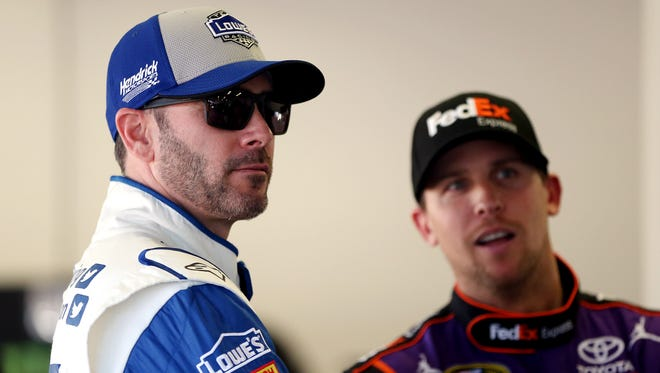 Jimmie Johnson (left) and Denny Hamlin traded paint at Martinsville on Sunday.