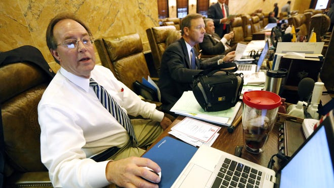 Rep. John Moore, R-Brandon, left, and row mate Rep. Mark Formby, R-Picayune, review specifics on proposed legislation during the 2015 legislative session. Moore said this year MAEP, the funding formula that determines the amount of money each school district receives, needs a review.